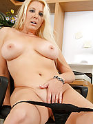 Tempting milf cougar secretary seductively shows her naked tanned body in the office