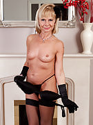 Golden-haired 42 yr old Cath Oakley slips off her black lingerie and additionally poses