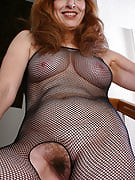 Redheaded grandma as part of the fishnet body shape stocking plays along with her feet