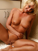 44 yr old golden-haired Barbie slips a few finger at this girl shaven mature hole