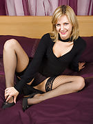 Hot blonde MILF Laurita showing away the lady black stockings in right here