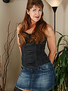 Andie shows off her denim skirt before showing away her hairy crotch