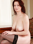 Busty and elegant redheaded MILF Carol shifts this girl massive bangers