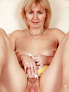 Busty golden-haired Nella from 30 plus Ladies spreads the lady meaty crotch open