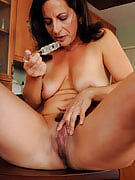45 spring familiar brunette along with big lifelike tits takes on with the glass vibrator