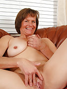 Horny older Carmen spreads wide to reveal an adult and additionally hairy pussy