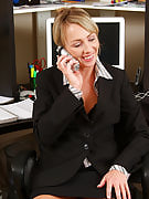 Mature secretary will get herself off while on the telephone with the customer
