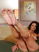 43 spring old MILF Chane strips and after that starts playing together with her feet