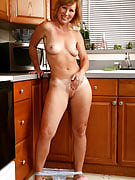 Sensuous MILF Cheyanne is comfortable spreading her crotch at just home