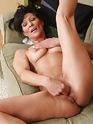 52 year familiar Kitty t after 30 plus Ladies plugs her fingers deep into this girl vagina