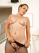 Serenity as part of a fishnet bodysuit spreads her adult ass and also pussy