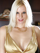 Stylish golden-haired MILF Slovanna slips away her dress to program off the lady breasts