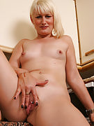 41 yr old MILF strips and additionally displays the pierced and shaven pussy