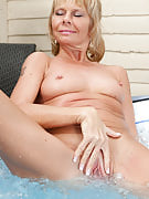 42 spring old golden-haired Cathy Oakley decides to get naked in the hot tub