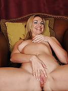Lovely MILF Samantha Rae slips away her processed spreads and also panties wide