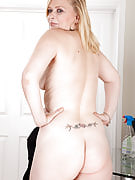 Feature adult model Tamara strips immediately after dusting the table