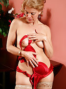 Elegant 48 year past times Lauren E showing away her red bra and also knickers