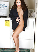 Cute brunette housewife takes a break from laundry to strip