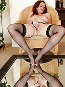 Busty brunette MILF Ryan looks into out her fine pussy in the mirror