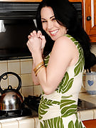 Gorgeous brunette RayVeness slips her finger into the lady crotch on the counter